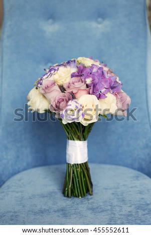 bridal bouquet of violet color on a blue background - stock photo