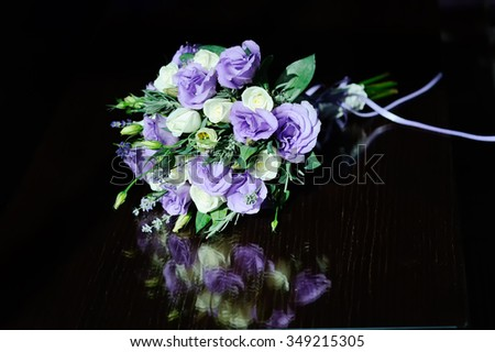 bridal bouquet of white and purple flowers