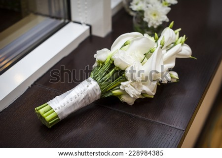 bridal bouquet of white callas. - stock photo