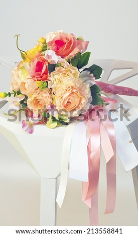 Bridal bouquet of white chairs placed