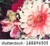 Bridal bouquet of white flowers on wooden surface. Wedding flowers, unusual designer florist bouquet of delicate roses. Wedding rings. Wedding bouquet, background. Empty wooden tabletop  - stock photo