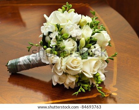 Bridal Bouquet on old and elegant table - stock photo