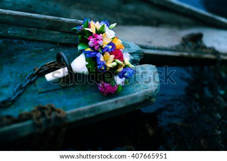Bridal bouquet. Wedding bouquet. Bouquet of flowers and boat chain. Flowers in boat. Bouquet of flowers - stock photo