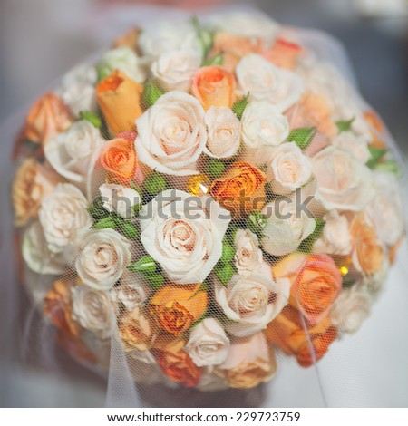 bridal bouquet with orange and white roses - stock photo