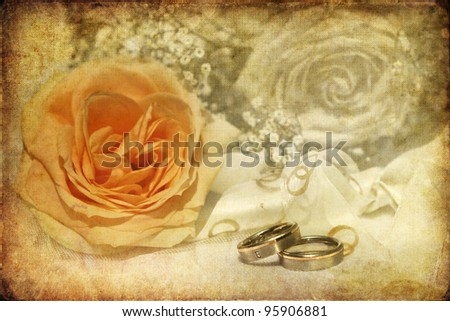 bridal bouquet with wedding rings processed with a decorative vintage texture