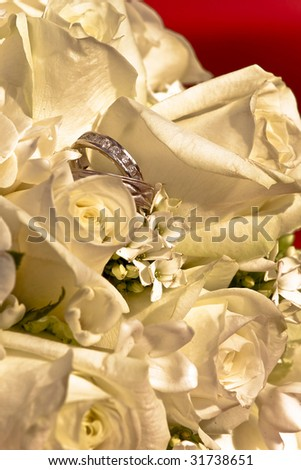 bridal bunch and engagement rings - stock photo