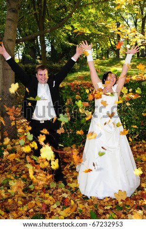 bridal couple in a autumnal wood - stock photo