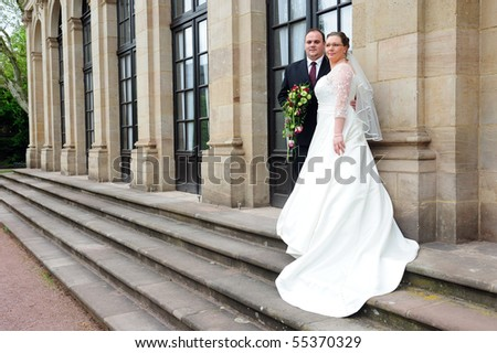 bridal couple in front of  baroque - building - stock photo