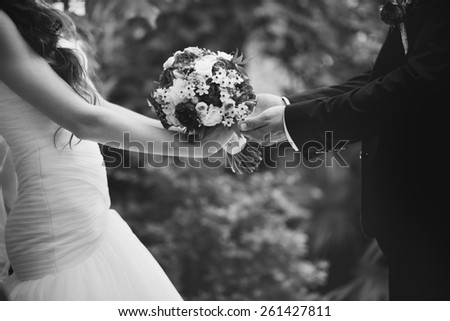 Bridal couple in love, wedding on summer day.  Picture in black and white.  - stock photo