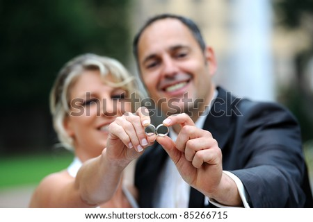 bridal couple is showing the rings - stock photo