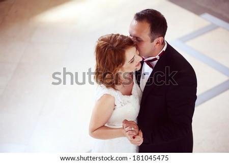Bridal couple kissing  - stock photo