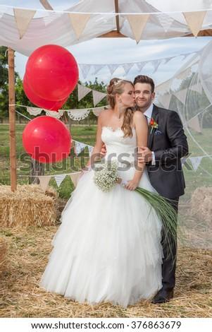 bridal couple newly weds at wedding kissing - stock photo
