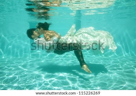 bridal couple underwater - stock photo