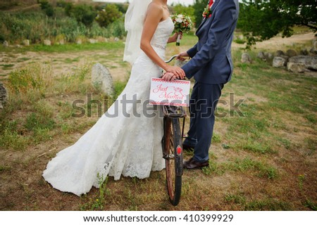 bridal couple with a bicycle - stock photo