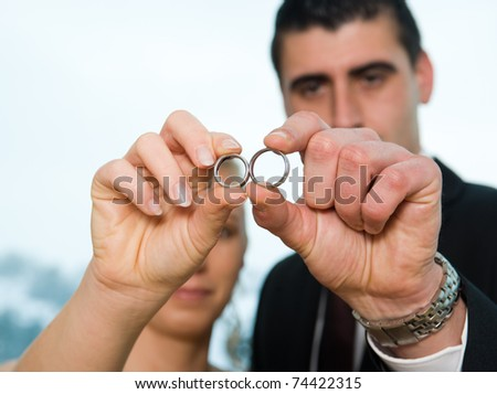 bridal couple with rings - stock photo