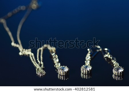 Bridal earrings and silver chain with reflection