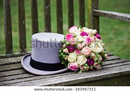 Bridal flowers and top hat - stock photo