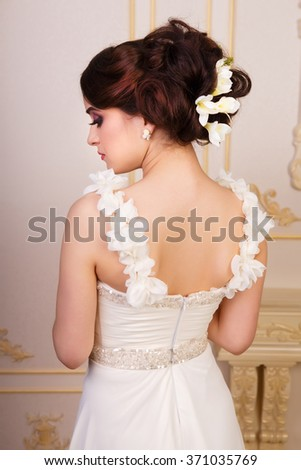 Bridal hairstyle with accessories from the back, close up shot - stock photo