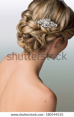 Bridal hairstyle with vintage style hair accessories. Blond Bride. View from the back  - stock photo