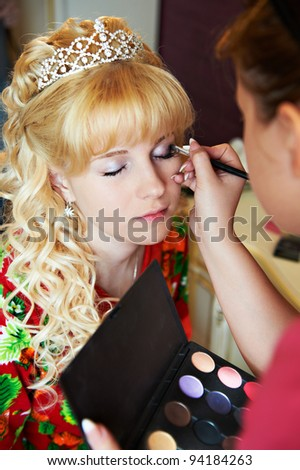 Bridal make-up in the morning of wedding day - stock photo
