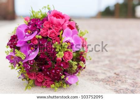 bridal wedding bouquet of flowers on wedding day - stock photo