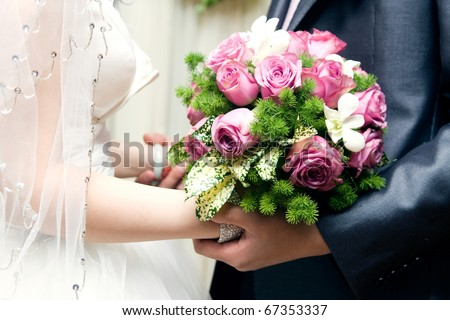 bride and bridegroom at wedding,hand in hand - stock photo