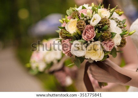 Bride and bridesmaids are holding bouquets