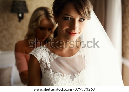 Bride and bridesmaids during the wedding preparations - stock photo
