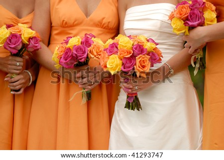 Bride and Bridesmaids holding Bouquets - stock photo