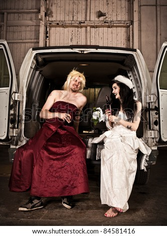 Bride and cross dressing bridesmaid at Hillbilly Wedding - stock photo