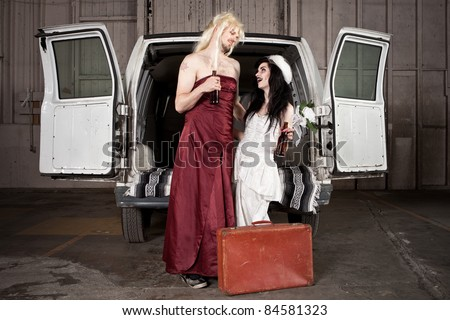 Bride and cross dressing Groom at Hillbilly Wedding - stock photo