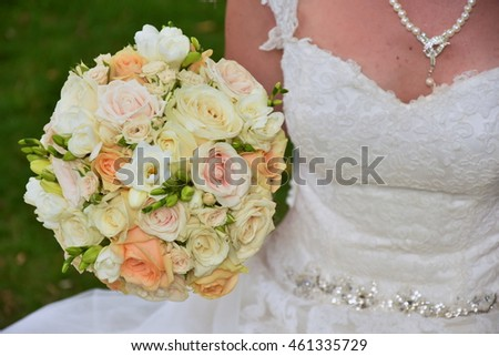 Bride and Decorative beautiful fresh wedding bouquets of colorful rose