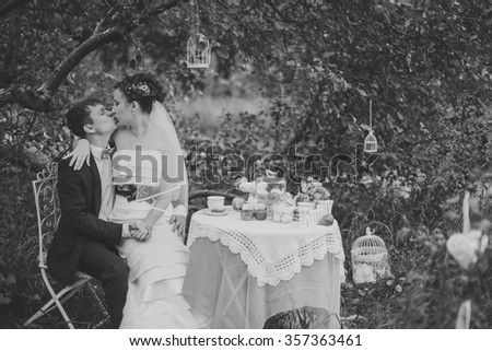 bride and groom and sweet table on the forest