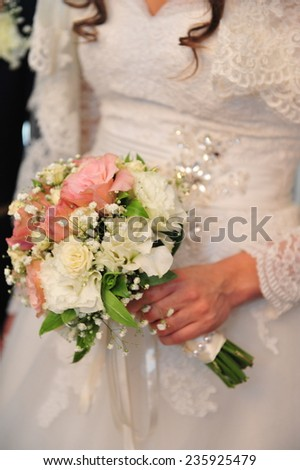 Bride and groom are holding champagne glasses. Wedding couple. The bride and groom. Bride and groom's hands with wedding rings - stock photo