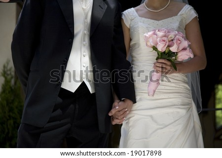 bride and groom at a wedding - stock photo