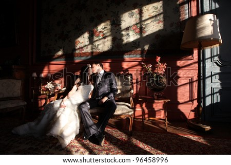 Bride and groom at a wedding in a old castle - stock photo