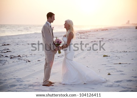 Bride and Groom at the Sunset - stock photo