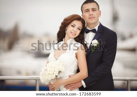 Bride and groom at wedding day outdoors. Newlyweds man and woman. Happy couple at wedding day.  - stock photo