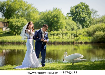 Bride and Groom at wedding Day walking Outdoors on spring nature. Bridal couple, Happy Newlywed woman and man embracing in green park.   - stock photo