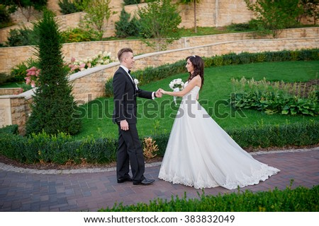 Bride and groom at wedding Day walking Outdoors on spring park
