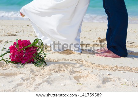 bride and groom, beach wedding for two - stock photo