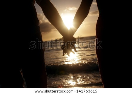bride and groom, beach wedding for two, silhouettes - stock photo