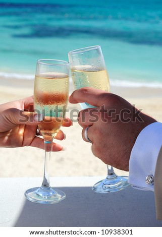 Bride And Groom Celebrating Their Marriage With Champagne - stock photo