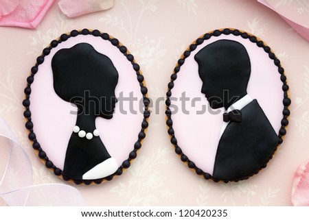 Bride and groom cookies - stock photo