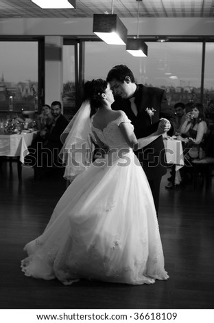 Bride and groom dancing - stock photo