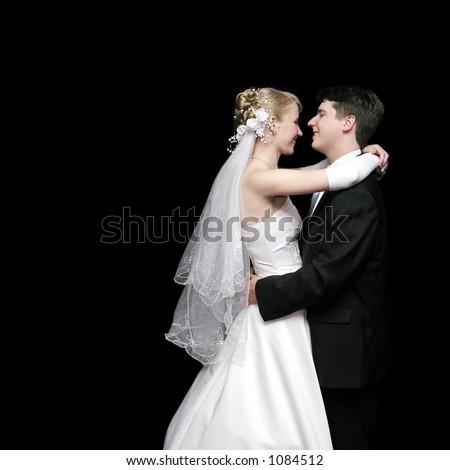 bride and groom dancing in the dark 2 - stock photo