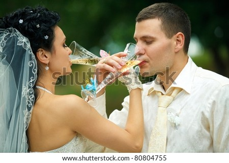 Bride and groom drinking champagne brotherhood - stock photo