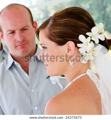 Bride and groom during a wedding ceremony.