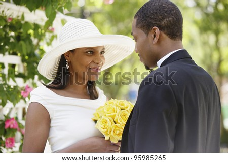 Bride and groom during wedding ceremony - stock photo