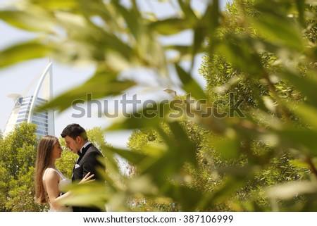 Bride and groom embracing in Dubai - stock photo